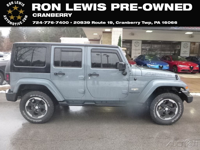 Pre Owned 2014 Jeep Wrangler Unlimited Sahara Utili In Cranberry